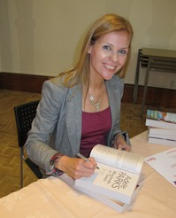 Thumbnail image for Adele signing books compressed.jpg