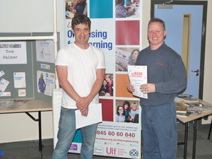 Martin Dixon receives his 6 book Challenge certificate from Tom Palmer 5.JPG