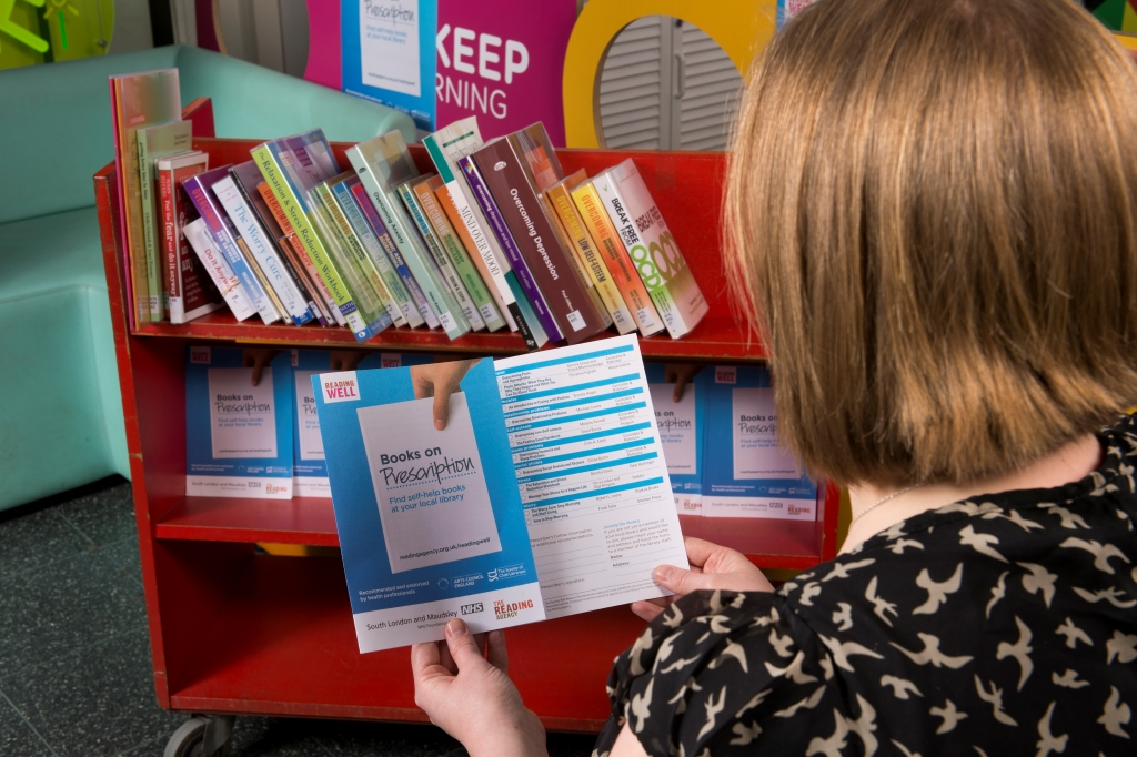 Self-help books from the library help Sally-Anne to carry on