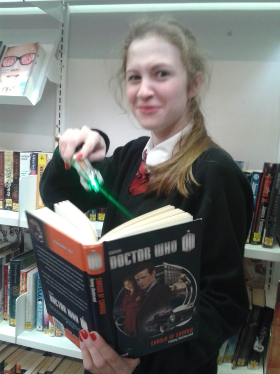 Amy McKee, 14, posing with a Doctor Who book and a sonic screwdriver!.jpg