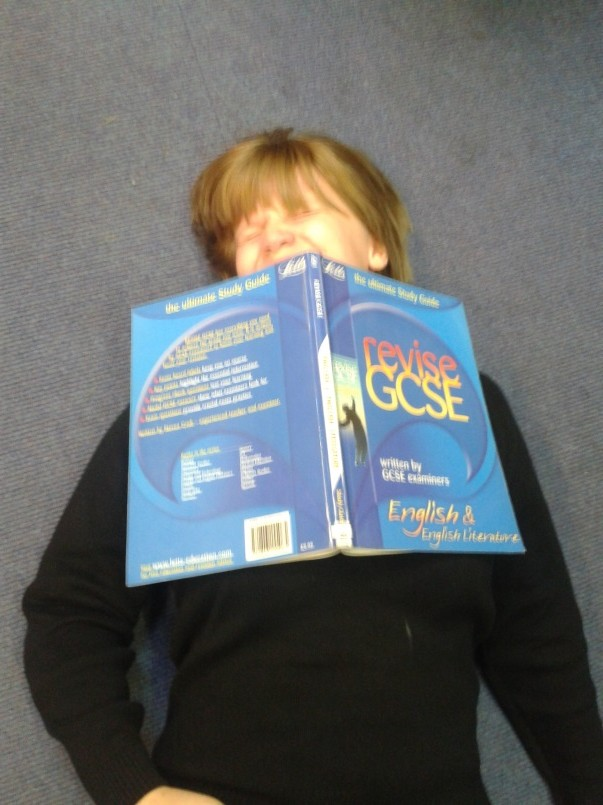 Molly Grey, 14, snoozes under a GCSE revision guide.jpg